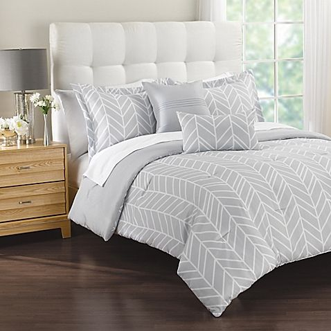 Crisp and fresh, unwind in your sanctuary with the Lauren 5-Piece Comforter Set. In soft grey, the microfiber comforter features a zigzag print, and includes two standard pillow shams, one square throw pillow, and one oblong throw pillow.