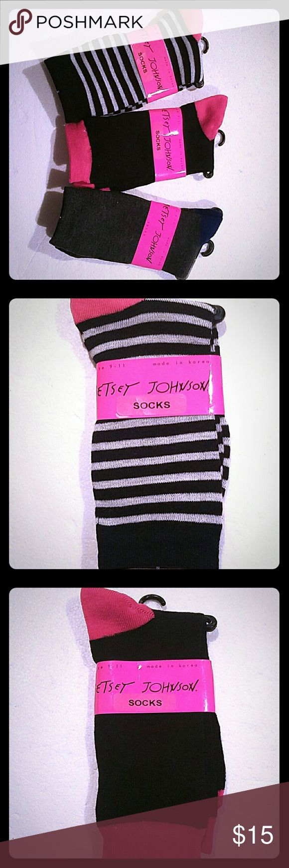 3 Pair of Betsey Johnson Trouser Socks You are purchasing 3 Pairs of fashion icon designer Betsey Johnson Trouser Socks.  Ladies Size 9-11. One pair is black with hot pink trim, one pair is black and white striped with pink trim and one pair is dark gray with a dark blue heel. They retail for $10 a pair. Get them here! Betsey Johnson Accessories Hosiery & Socks
