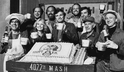 <3 this a awesome picture!!! Cast and crew members of television's M.A.S.H. celebrate the start of production of their 8th season with a toast of the mini-bed-pan-cups in Los Angeles, July 10, 1979.