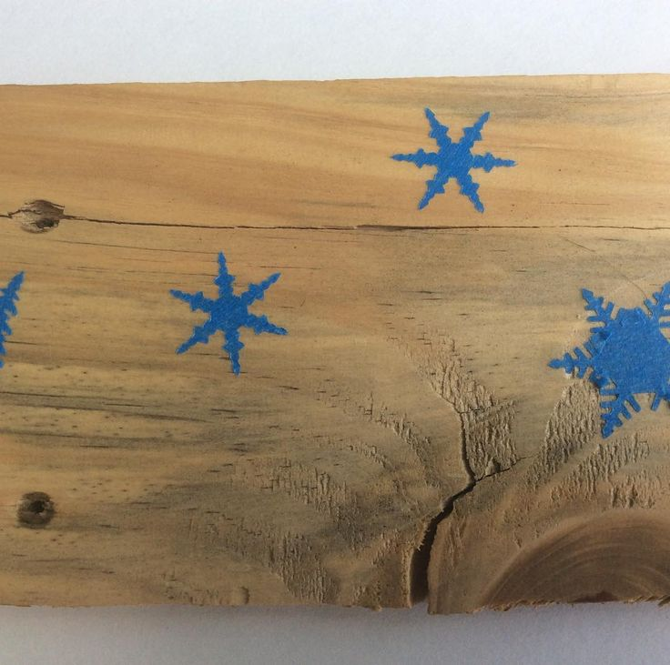 Experimenting with paint tape punch outs on planes pallet wood.