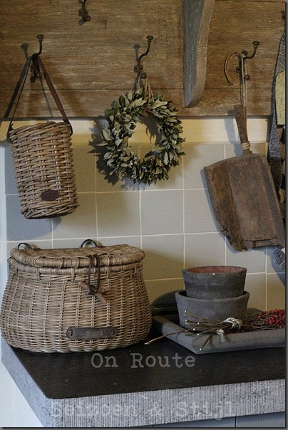 Love the farmhouse feel to this; the barn board coat rack with baskets would be great in a mud room