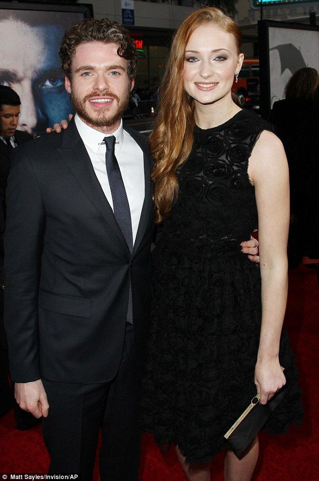 Cuddling up: Meanwhile, onscreen brother and sister team Richard Madden and Sophie Turner were also reunited at the star-studded event  Read more: http://www.dailymail.co.uk/tvshowbiz/article-2295617/Emilia-Clarke-reunited-screen-husband-Jason-Momoa-attends-Games-Of-Thrones-premiere-alongside-glamorous-female-stars.html#ixzz2sDA33NQN  Follow us: @MailOnline on Twitter   DailyMail on Facebook