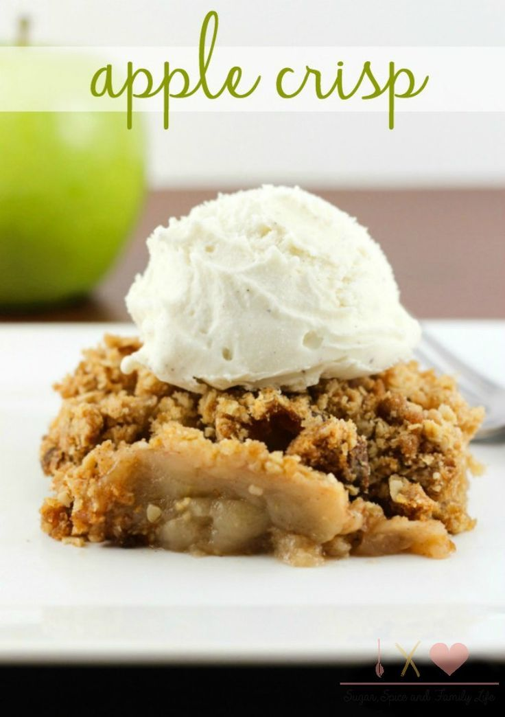 Hot Apple Crisp topped with vanilla ice cream is a perfect dessert to enjoy during the fall or winter. This apple dessert aka apple crumble features baked apples covered in a delicious streusel topping. - Apple Crisp Recipe on Sugar, Spice and Family Life