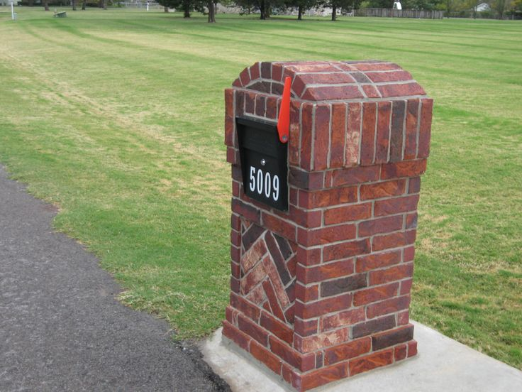 Custom flag attachment for brick column mailbox installation http://www.mailboss.com/blog/flag-attachment-for-brick-column-installations/