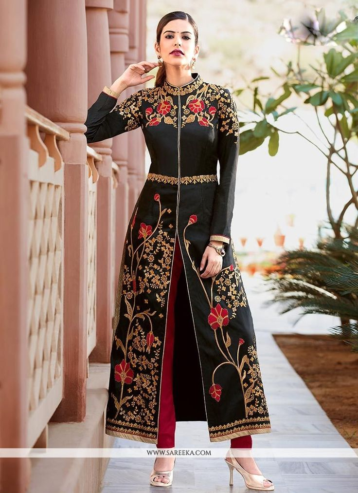 Create a smoldering impact by this black tafeta silk pant style suit. It is uniquely crafted with embroidered, resham and zari work. Comes with matching bottom and dupatta. (Slight variation in color,...