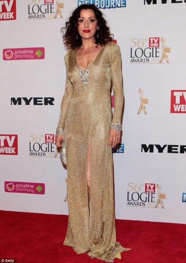 Going for Gold; Arena made her red carpet appearance at the awards in a floor length gown ...