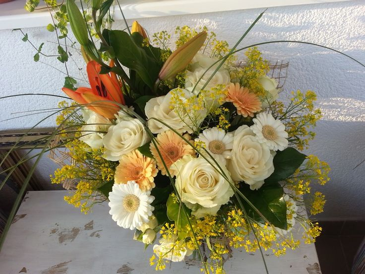 Enormous bouquet with lillies, roses and germini; sweet cmbination of orange and cream.