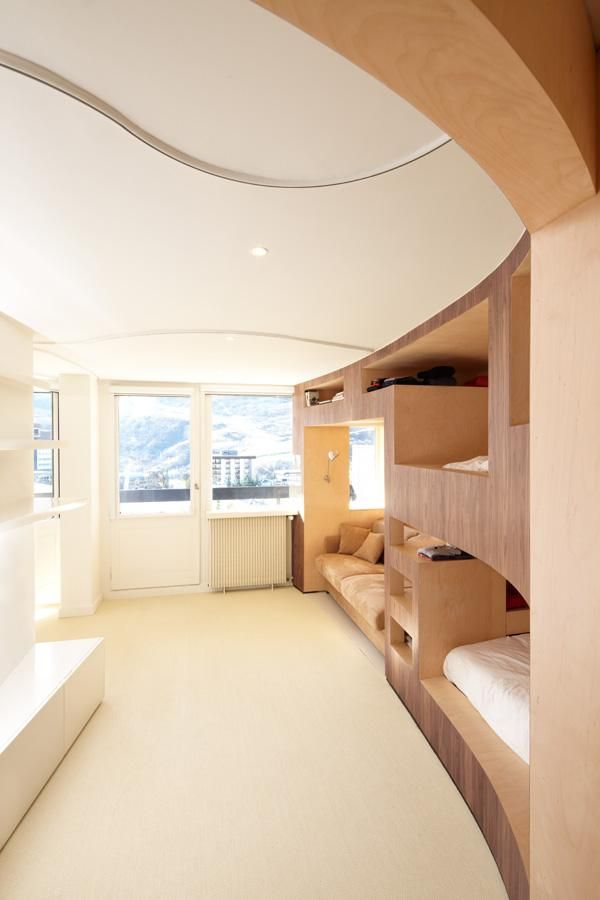 Neat for boys room, chic bunk beds. Bedroom At The Cabin by H2O Architectes