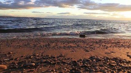 last sunset light over seashore