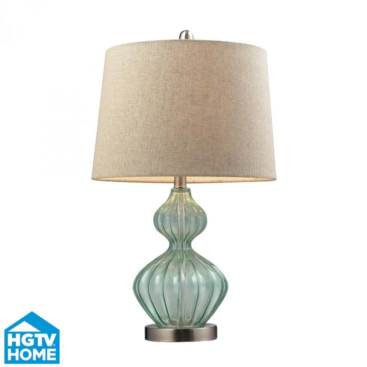 The seaglass colored base and sand colored shade make this table lamp fitting for a beach