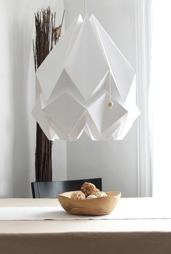 HANAHI (a flower in Japanese) is a handmade lamp shade made in high quality paper using the ancient Japanese paper folding method Origami,