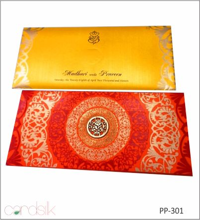 A beautiful red designer piece with central Ganeshji carved in a metal. Golden yellow envelope adds the grace. #IndianWedding #Wedding #Invitation #Design #IndianWeddingInvitations