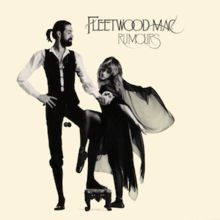 """Mostly cream album cover with black-and-white image of tall, bearded gentleman holding the hand of blonde, cape-wearing woman. In the top right-hand corner, it is captioned """"FLEETWOOD MAC"""" and """"RUMOURS"""" below it."""