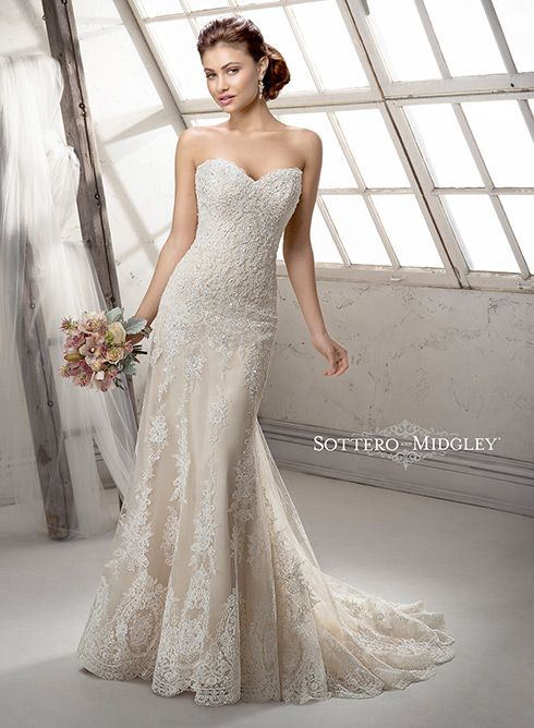Dramatic lace wedding dress with romantic sweetheart neckline, Viera by Sottero and Midgley. Finished with Swarovski crystals and embroidered lace hemline.
