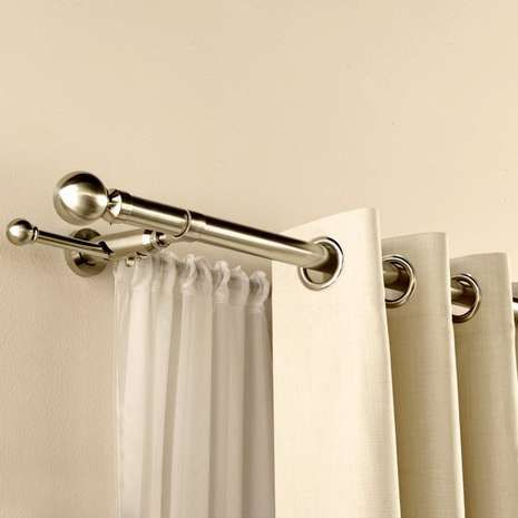 Hang up a pair of curtains on one pole, and a voile on another to create a…