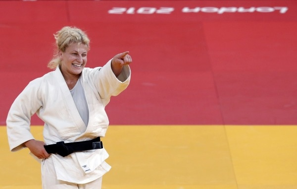 Kayla Harrison won the first judo gold in U.S. history. But she has a much bigger mission — to speak out against sexual abuse. http://ti.me/N69tPk