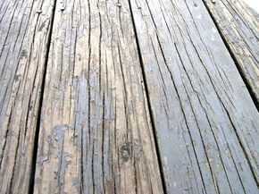 How to stain and repair a peeling pressure treated wood deck.   We've lived here for 5 years now, and have always talked about fixing up the...