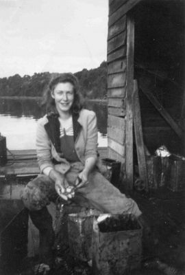 Betty Brown splits scallops at a Channel scalloping shed c. 1930s