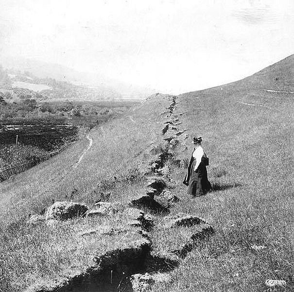 A woman stands near the 1906 ground rupture northwest of Olema in Marin County. The rupture was the result of the 1906 San Francisco Earthquake.