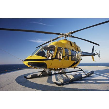 A Bell 407 utility helicopter on the helipad of an oil rig Canvas Art - Terry MooreStocktrek Images (35 x 24)