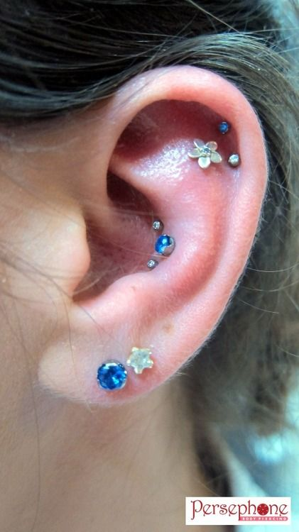persephonebodypiercing:    I've posted photos of this client several times before, but we've just updated some jewellery!  Jewellery by Anatometal in everything except that second earlobe piercing!