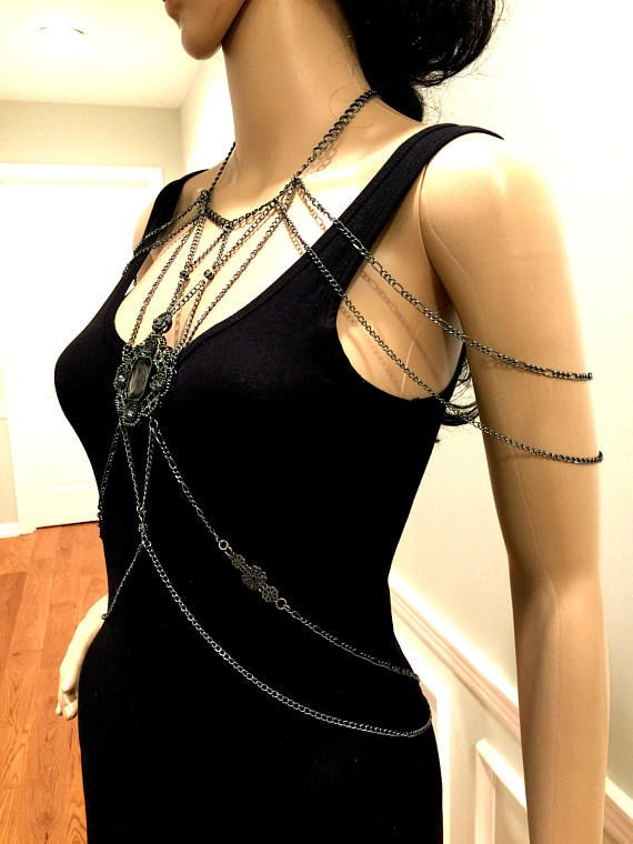 """Made of gun-metal color chains and charm. Fits sizes: """"XS"""", """"S"""", """"M"""", and """"L"""". Wears easily like a necklace. It opens/closes with lobster clasps on the back of the neck and waist."""