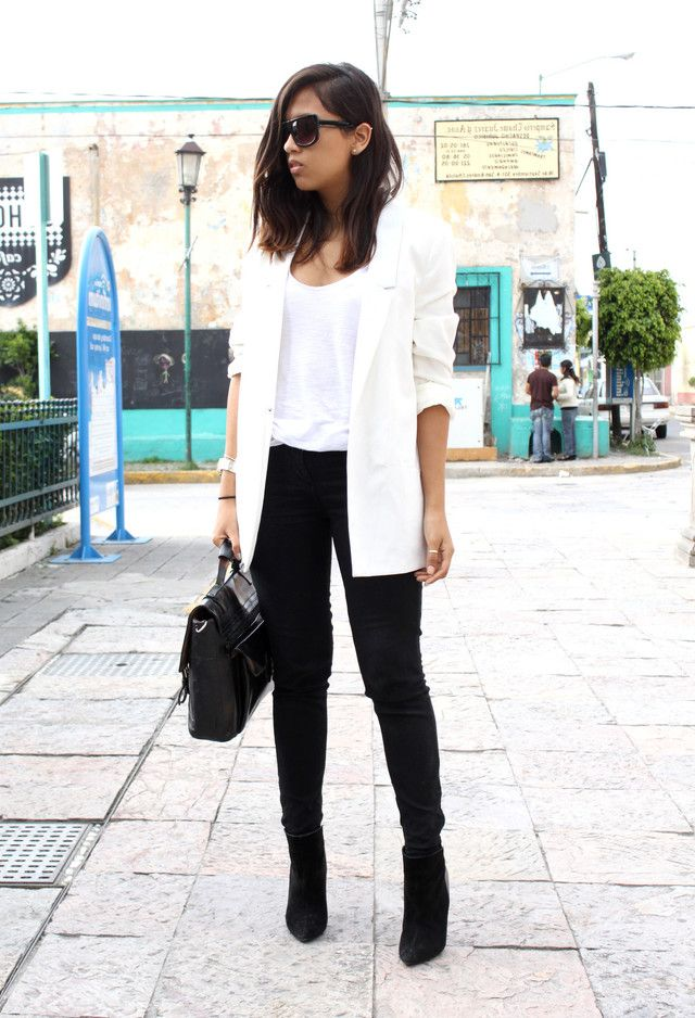 Elongate your legs with black skinnies and pointed black booties. Pair the outfit with a white jacket or blazer for a chic modern vibe.