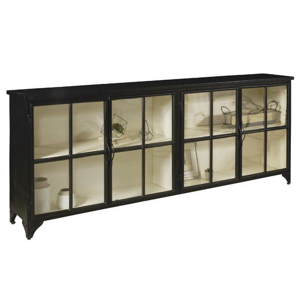 The coolness of black metal combines with a soft cream painted interior—much like the mountains of North Carolina in winter!  The Sugar Mountain Metal Console is a study in contrasts. Stationary shelves with glass doors provide a perfect display area. The Sugar Mountain Metal Console is part of Eric Church's Highway to Home collection.