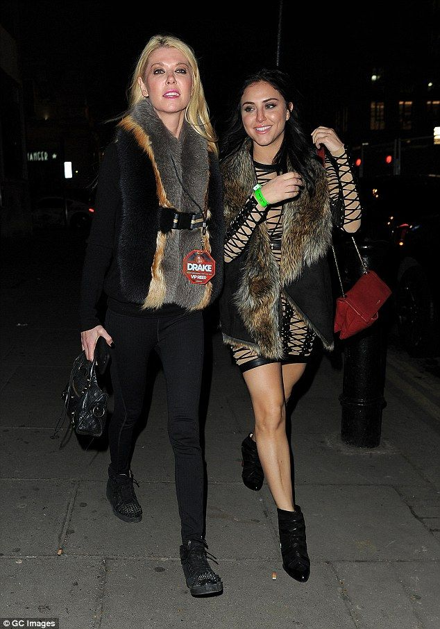 Night out: Tara Reid, 41, looked sartorially savvy as she headed to TAPE nightclub in London with a pal following a Drake concert on Tuesday night