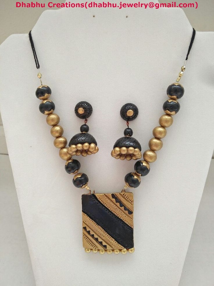 Black and gold necklace with  jhumkas