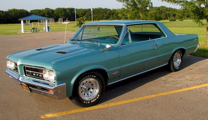1964 Pontiac GTO. In my opinion this was the GTO's best year.