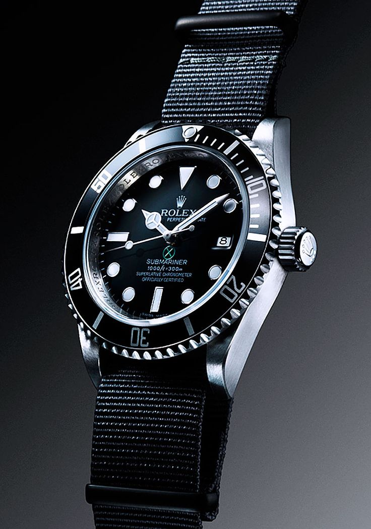 """The Project X Designs PXD SS1 is a highly customized 50th Anniversary Rolex LV Submariner with the following changes:    • Green Bezel is swapped with authentic black Rolex Submariner Bezel.  • Project X Designs green """"X"""" in circle logo applied to dial just above Submariner designation.  • Crown Guards Carefully shaved off with updated winding crown tube.  • Rolex Trademark Submariner Cyclops Date Magnifier removed."""