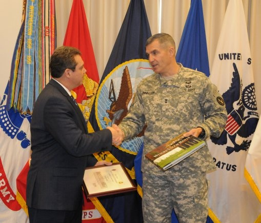 Maj. Gen. Michael S. Linnington, commander of the Joint Force Headquarters - National Capital Region and the U.S. Army Military District of Washington presents Jim Knotts, the chief executive officer of Operation Homefront a Certificate of Appreciation during a ceremony held at Fort Lesley J. McNair, March 8, 2013.