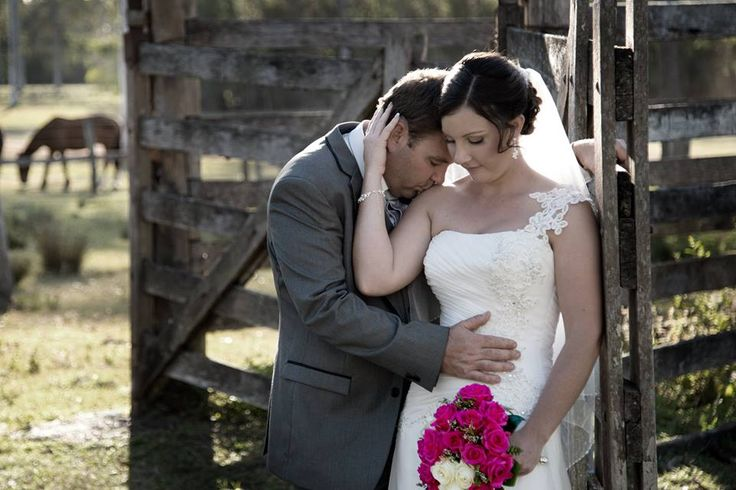 country background, cattle yards, wedding.  lovely combination.