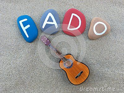 Stones conposition and a miniature of guitar symbols of Fado, portuguese traditional music