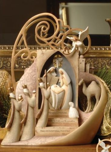 There is something very elegant and lovely about the shapes of this nativity. I also like the camel tucked away in the corner.