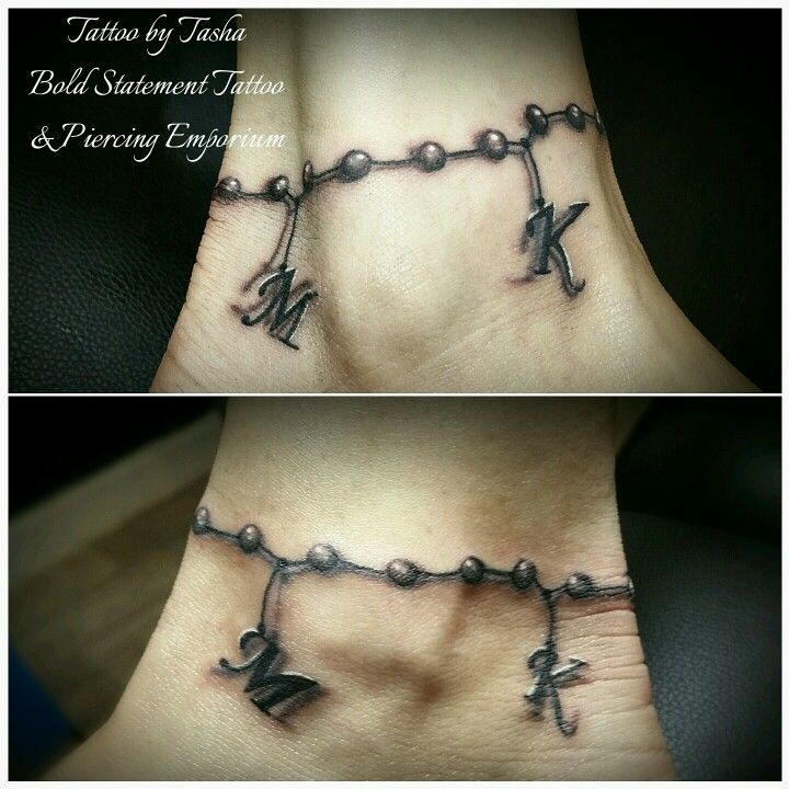 Black and grey freehand ankle bracelet tattoo