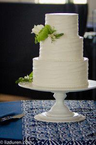 beach wedding  simple white cake  white, green, navy wedding