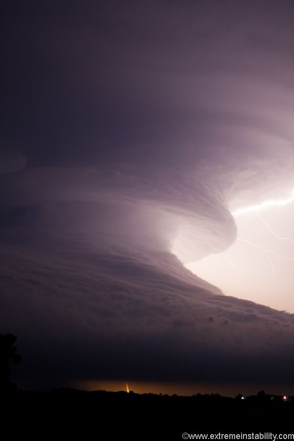 Image by Mike Hollingshead | Caption: An amazing supercell tracks across southern Nebraska, producing other-worldy storm structures. At times this storm looked like a giant tsunami in the sky. The supercell formed after two supercells merged near McCook Nebraska.