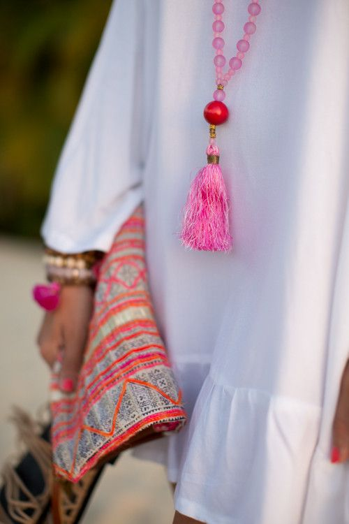Beautiful white dress, tassel necklace, and patterned  clutch-Sundress at Sunset - Gal Meets Glam
