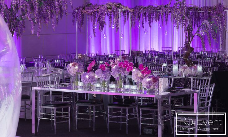 Gorgeous Head Table!! Glowing flowers arranged beautifully topped with cascading orchids! Full service event decor by R5 Event Design
