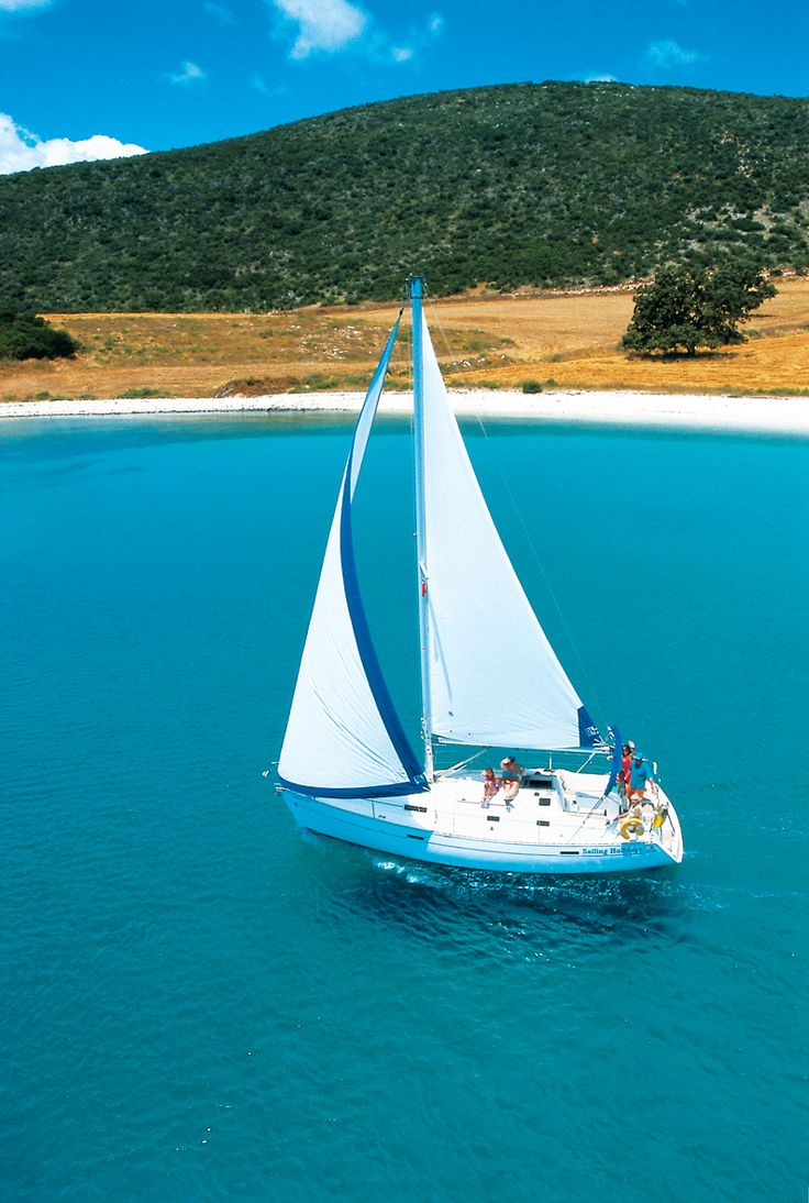 A Beneteau sailing past the gorgeous hay field in Goat Bay...