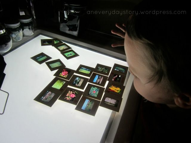 Reggio Light Panel Activities - looking at old slides {An Everyday Story}
