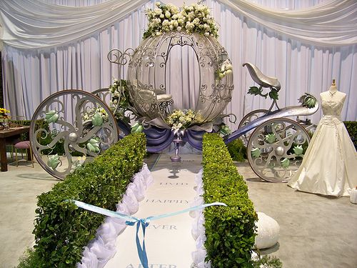 bridal show booth ideas | The Cinderella Coach at the Fairy Tale Weddings booth at the D23 Expo