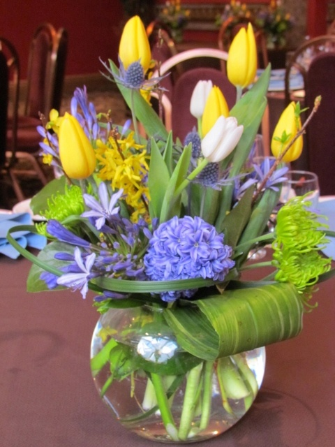 Bridal Shower or Baby Shower Centerpiece ~  Agapanthys, hyacinths, tulips and forsythia make a spring centerpiece bright and cheerful! Not to mention the amazing fragrance that the hyacinths express. Designed by www.grandentrancedesign.com