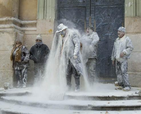 Revelers take part in the battle of Enfarinats in the town of Ibi in south-eastern Spain. For 200 years Ibi's citizens have celebrated El Dia de los Santos Inocentes with a battle using flour, eggs and firecrackers outside the town hall.