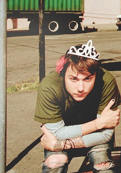 Frank Lero, looking totally punk- rock wearing a pink flower and tiara, while also rocking black nail polish.........