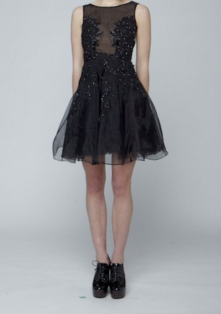 Designed by Narces, this little black dress features a gorgeous 100% silk organza full skirt dress over black lining, with a sheer top.  The bead and lace embellishment provides coverage and stunning detail.  Available through Pinktiger.com.