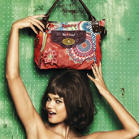 Desigual Women's Macbee Seduccio bag. Wear it or carry it by the short handles, the strap is detachable.