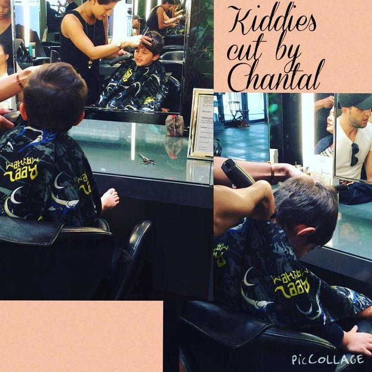 Little cutie enjoying having his hair cut by Chantal at Midori